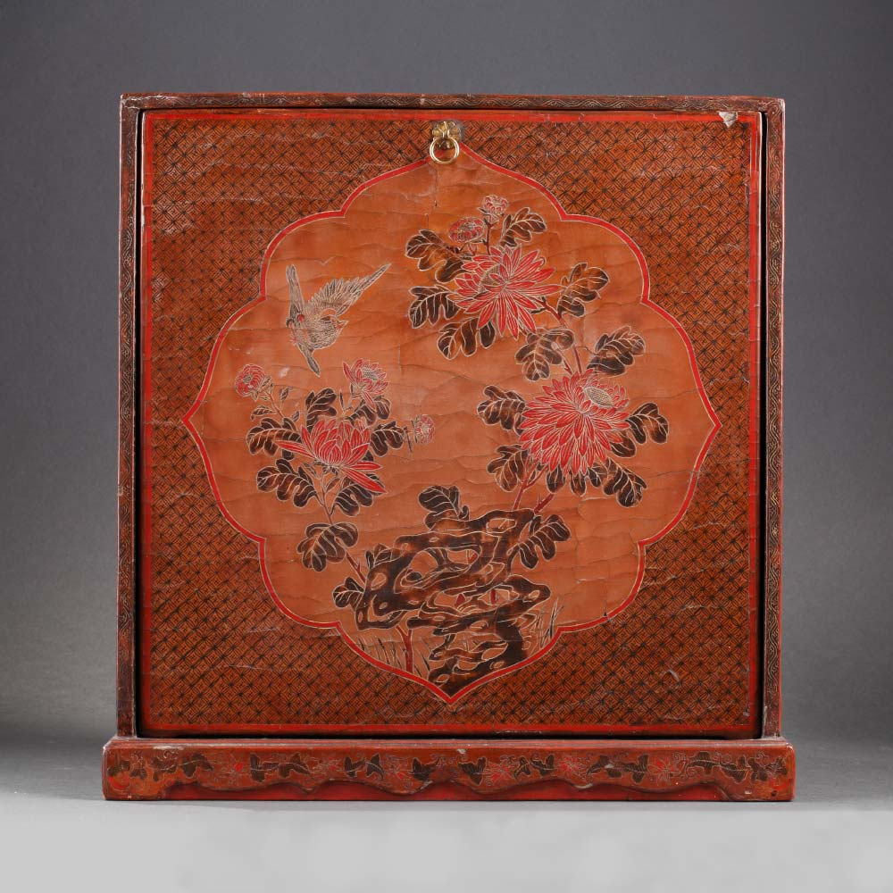 A small tianqi lacquer cabinet with birds among flowers - 1